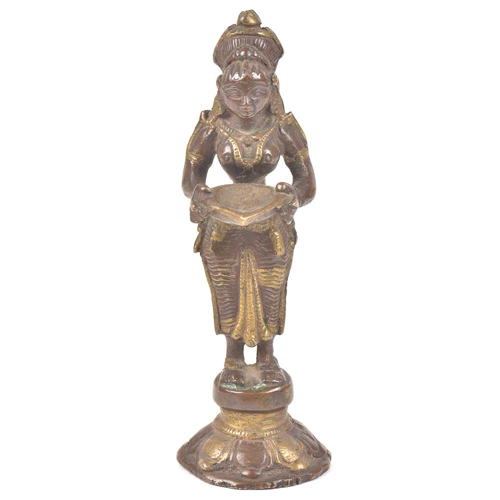 Bronze Lady Holding A Diya In Her Hand Is On A Raised Platform