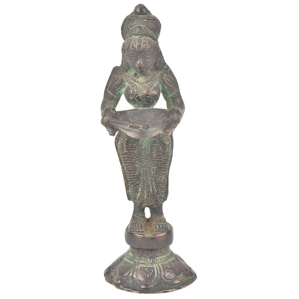 Bronze Lady Holding A Diya In Her Hand Is On A Raised Platform With Patina