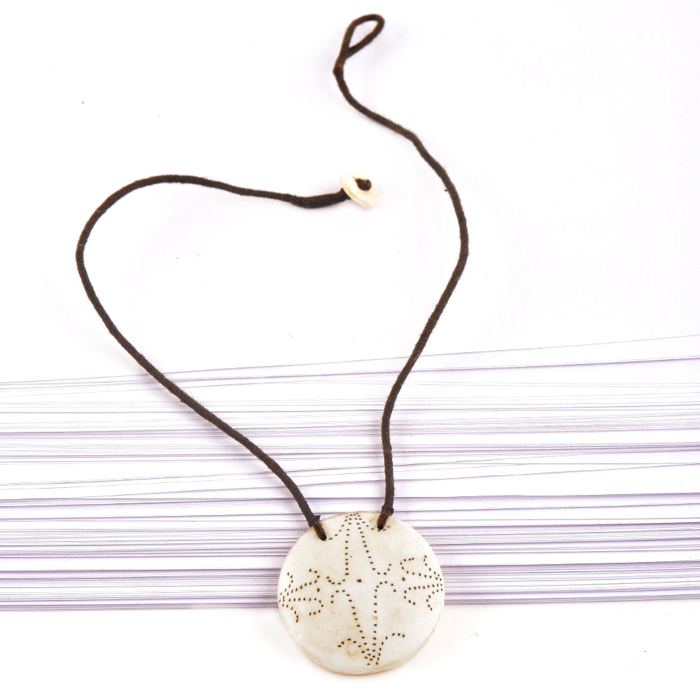 Star Engraved White Shell Pendant With Black Cord