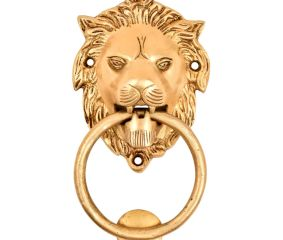 Brass Lion Head Door Knocker With A large Brass Ring Gripped In Its Mouth