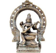 Goddess Saraswati Playing Veena with Floral Prabhavali