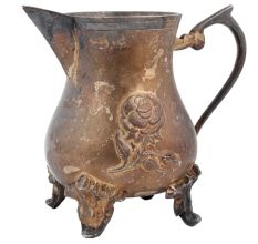 Ornate Brass Jug Or Pitcher With Rose Relief Design On Three Legs