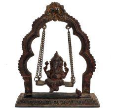 Brass Ganesha Sitting On Swing With Decorative Prabhavali