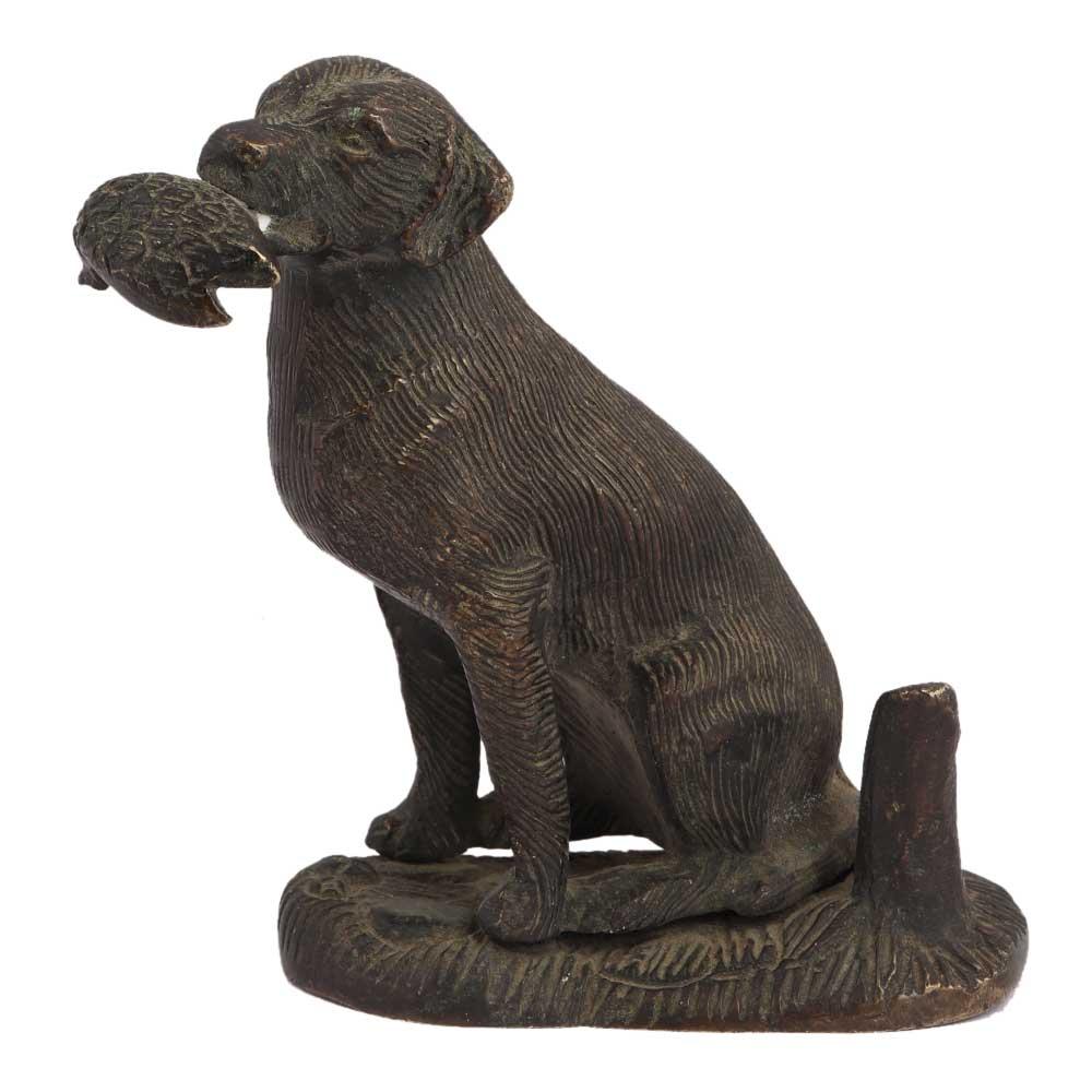 Brass Sitting Dog Statue Holding Flesh Of A Animal